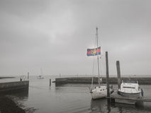 Barca a vela con la bandiera Fotografia Stock Libera da Diritti