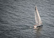 Sailboat sailing in the sea stock photo