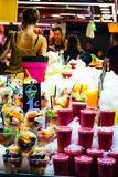 Barcellona, Spain 08 September 2018: La Boqueria Market Fresh fruit cocktails. Some healty fruit cocktails are drowned in the ice stock images