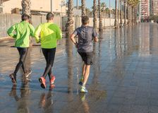 Barcelona, ​​Spain - March 17, 2019: Men jogging near to the sea.  royalty free stock photography