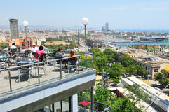 Barcelona. Spain - 08 July, 2012: Tourists admiring  skyline from a restaurant terrace in Miramar, Montjuïc stock photo