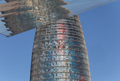 Barcelona Agbar Tower skyscrapper reflection at Els encants mirror structure. Agbar tower in Barcelona rounded skyscrapper building by Jean Nouvel architect Stock Photography