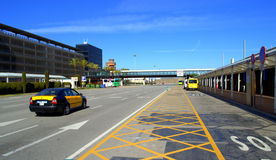 Barcelona airport street. Taxi car move on street by car parking building and Terminal at Barcelona Airport,Spain on nice spring day Stock Photo