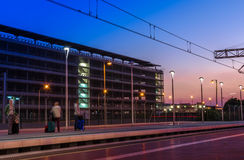 Barcelona airport train station. Tourists waiting in Barcelona airport train station at sunset stock photography