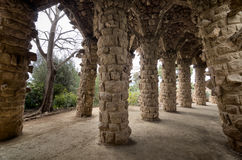 Barcelona: Amazing stone arches at Park Guell, the famous and beautiful park designed by Antoni Gaudi Stock Photography