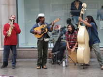 Barcelona april 2012, street musicians. In front of a shop window Stock Images