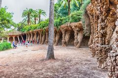 Colonnaded pathway in Park Guell, Barcelona, Catalonia, Spain. BARCELONA - AUGUST 9: Colonnaded pathway made with masonry arcades in Park Guell, Barcelona Royalty Free Stock Images
