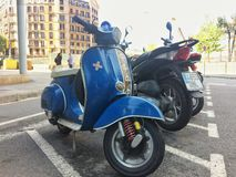 Barcelona, AV Diagonal, April 2016: blue retro vintage scooter Vespa Stock Images