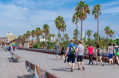 Barcelona avenue with tourists and palm trees. A walk on Barcelona avenue with tourists and palm trees stock photo