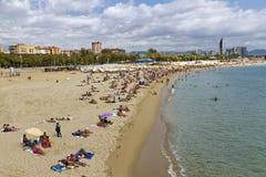Barcelona, Barceloneta beach Bogatell. BARCELONA - SEPTEMBER 04: Crowd enjoy sunny day at the Mediterranean beach in Barcelona September 04, 2011 in Barcelona Royalty Free Stock Image