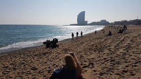 Barcelona Beach. February on Barcelona Beach. People relaxing Royalty Free Stock Photo