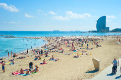 Barcelona beach. BARCELONA, SPAIN - SEPT 23, 2013: People at Barcelona city beach. 400 meters long, it is one of 10 best urban beaches of the world Stock Images