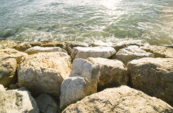 Barcelona beach stone pier in the Barceloneta.  Royalty Free Stock Image