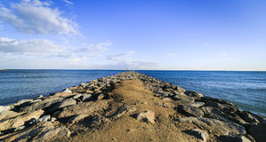 Barcelona beach stone pier in the Barceloneta.  Stock Photo