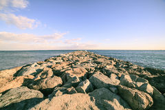 Barcelona beach stone pier in the Barceloneta.  Stock Images
