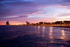 Barcelona beach at the sunset. Barcelona beach and sea in the sunset light - Spain Royalty Free Stock Images