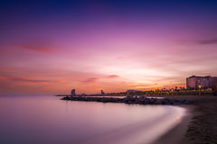 Barcelona beach at the sunset Stock Photos