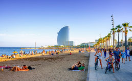 Barcelona Beach. Tourists  along Barcelona beach  in the summer, Catalunya, Spain Royalty Free Stock Photos