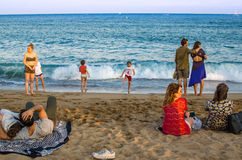 Barcelona beach with tourists. Enjoying the sun and sea Royalty Free Stock Photo