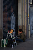 BARCELONA, CARRER DE RIBES, JANUARY 2016- street graffiti artist. Paint shop Royalty Free Stock Photos