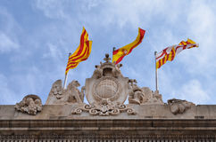 Barcelona, Catalonia flags. On top of stone building Stock Photo