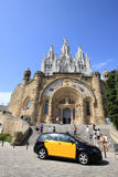 Barcelona, Catalonia, Spain - August 29, 2012: Expiatory Church of the Sacred Heart of Jesus on Tibidabo. City taxi standing in front of stairs of Church of the Stock Images