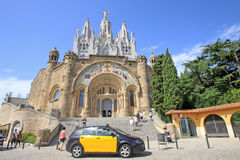 Barcelona, Catalonia, Spain - August 29, 2012: Expiatory Church of the Sacred Heart of Jesus on Tibidabo. City taxi standing in front of stairs of Church of the Royalty Free Stock Images