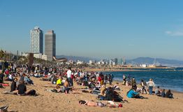 Barcelona city beach. BARCELONA, CATALONIA, SPAIN, March, 2018: Barcelona city beach with people sunbathing and enjoying the sea view. Barceloneta area Royalty Free Stock Photography