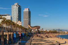 Barcelona city beach, Barceloneta area. BARCELONA, CATALONIA, SPAIN, March, 2018: Barcelona city beach with people sunbathing and enjoying the sea view Royalty Free Stock Photo