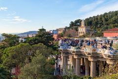 Park Guell, tourist attraction in Barcelona. BARCELONA, CATALONIA, SPAIN, March 2018: tourists enjoying Barcelona views at the central terrace of the park Guell royalty free stock images