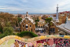 Park Guell tourist landmark in Barcelona. BARCELONA, CATALONIA, SPAIN, March 2018: tourists at the park Guell. Aerial view of the gingerbread house. Park Guell Royalty Free Stock Photography