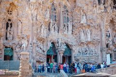 Group of tourists queuing at the entrance of Sagrada Familia. royalty free stock photography
