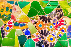Barcelona, Catalonia, Spain: mosaic in the Park Guell of Antoni Gaudi. At sunset Royalty Free Stock Photo