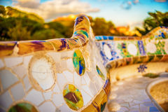 Barcelona, Catalonia, Spain: mosaic in the Park Guell of Antoni Gaudi. At sunset Stock Photos