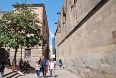 Barcelona Cathedral in Catalonia. Tourists walk past the medieval Cathedral of the Holy Cross and Saint Eulalia in Barcelona, Spain on April 17, 2018 royalty free stock photo