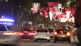 Barcelona Christmas Street Lights Decorations and Traffic 4k. Time lapse vehicles on the streets and squares of the city at Christmas time stock video footage