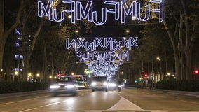 Barcelona Christmas Street Lights Decorations and Traffic 4k. Time lapse vehicles on the streets and squares of the city at Christmas time stock video