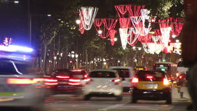 Barcelona Christmas Street Lights Decorations and Traffic. Time lapse vehicles on the streets and squares of the city at Christmas time stock video