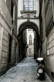Alley in Barcelona City. Deserted alley in Barcelona City Gothic Quarter with a parked moped royalty free stock photography