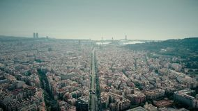 Barcelona city and distant sea port. Barcelona city aerial shot, Spain. Distant sea port. 4K clip stock video footage