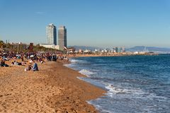 Barcelona city beach, Barceloneta area. BARCELONA, CATALONIA, SPAIN, March, 2018: Barcelona city beach with people sunbathing and enjoying the sea view Stock Photo