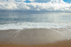 Barcelona city beach, cloudy weather. Mediterranean sea coast. Restless wave is coming Stock Illustration