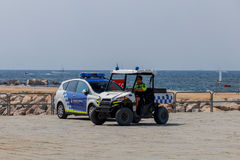 Barcelona. City Beach. Barcelona, Spain - July 15, 2016 :The beach police on cars patrol the public beach of Barcelonetta.. Barcelona. Spain Royalty Free Stock Photography