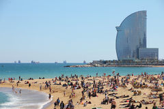 Barcelona, city beach, Spain. Barcelona, city beach,  400 meters long, it one of 10 best urban beaches of the world. Tourists rest along Barceloneta beach, May Royalty Free Stock Photos