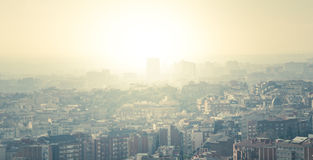 Barcelona, a city. Cityscape of Barcelona in a sunny and idyllic day. A beautifying luminous mist cover the view Royalty Free Stock Photos