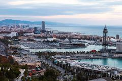 Barcelona city at sunset. Pink sky on background. View from top. Spain stock photo