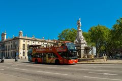 Barcelona city tour bus. BARCELONA, SPAIN - APRIL 9, 2017: Barcelona city tour bus near Fountain on Pla de Palau square in Barcelona, Spain stock photos