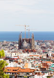 Barcelona city view with Sagrada Família cathedral and Mediterranean Sea. stock photos