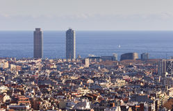 Barcelona city view, Spain. Barcelona view : Port Olimpic Towers, houses and the see. Barcelona, Spain Royalty Free Stock Photo