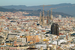 Barcelona cityscape at midday. Sagrada Familia stands at the right stock photography